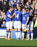 Pictured: Steven Naismith (L) of Everton celebrating his goal with team mates. Sunday 16 February 2014<br /> Re: FA Cup, Everton v Swansea City FC at Goodison Park, Liverpool, UK.