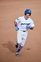 Rylan Bannon (18) of the Ogden Raptors circles the bases after tagging a three run homer against the Great Falls Voyagers at Lindquist Field on September 14, 2017 in Ogden, Utah. The Raptors defeated the Voyagers 7-4 in Game One of the Pioneer League Championship. (Stephen Smith/Four Seam Images)