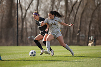 LOUISVILLE, KY - MARCH 13: Emily Fox #11 of Racing Louisville FC and Alina Stahl #24 of West Virginia University battle for the ball during a game between West Virginia University and Racing Louisville FC at Thurman Hutchins Park on March 13, 2021 in Louisville, Kentucky.