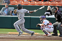 Left fielder Demetrius Jennings (1) of the Wofford College Terriers bats in a game against the Clemson University Tigers on Tuesday, March 1, 2016, at Doug Kingsmore Stadium in Clemson, South Carolina. The Clemson catcher is Chris Okey. Clemson won, 7-0. (Tom Priddy/Four Seam Images)