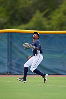GCL Rays outfielder Christian Johnson (4) tracks a fly ball during a Gulf Coast League game against the GCL Pirates on August 7, 2019 at Charlotte Sports Park in Port Charlotte, Florida.  GCL Rays defeated the GCL Pirates 5-3 in the second game of a doubleheader.  (Mike Janes/Four Seam Images)