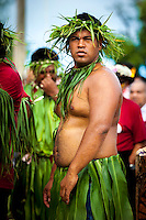 A man dressed in traditional Polynesian costume participates in a parade as part of the investiture of Makirau Haurua, Aitutaki Island, Cook Islands.