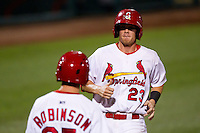 Ryan Jackson (23) of the Springfield Cardinals heads back to the dugout after scoring during a game against the Tulsa Drillers at Hammons Field on July 19, 2011 in Springfield, Missouri. Tulsa defeated Springfield 17-11. (David Welker / Four Seam Images)