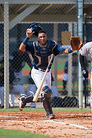GCL Tigers East catcher Gresuan Silverio (18) throws to first base during a game against the GCL Tigers West on July 20, 2017 at TigerTown in Lakeland, Florida.  GCL Tigers West defeated GCL Tigers East 6-5.  (Mike Janes/Four Seam Images)