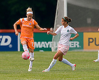 Sky Blue FC midfielder Kelly Parker (7) makes a pass as St Louis Athletica forward Angie Woznuk (11) pressures during a WPS match at Anheuser-Busch Soccer Park, in St. Louis, MO, June 7, 2009. Athletica won the match 1-0.