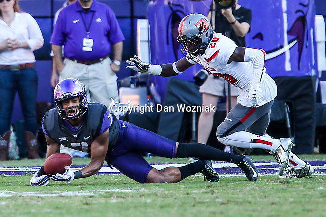 TCU Horned Frogs wide receiver Kolby Listenbee (7) and Texas Tech Red Raiders defensive back Tevin Madison (20) in action during the game between the Texas Tech Red Raiders and the TCU Horned Frogs at the Amon G. Carter Stadium in Fort Worth, Texas. TCU defeats Texas Tech 82 to 27.