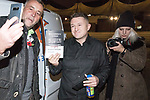 """© Joel Goodman - 07973 332324. 03/11/2017 . Manchester , UK . LUTZ BACHMANN , founder of the PEGIDA movement poses with TOMMY ROBINSON (real name Stephen Yaxley-Lennon ) at the launch of the former EDL leader's book """" Mohammed's Koran """" at Castlefield Bowl . Originally planned as a ticket-only event at Bowlers Exhibition Centre , the launch was moved at short notice to a public location in the city . Photo credit : Joel Goodman"""