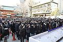 Business people offer prayer at Kanda Myojin Shrine in Tokyo