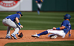 Gavin Lux tags Josh Jung during a spring training game between the Texas Rangers and Los Angeles Dodgers in Surprise, Ariz., on Sunday, March 7, 2021.<br /> Photo by Cathleen Allison