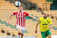 13th February 2021; Carrow Road, Norwich, Norfolk, England, English Football League Championship Football, Norwich versus Stoke City; Harry Souttar of Stoke City and Teemu Pukki of Norwich City compete for the ball