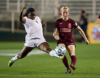 Jamia Fields (4) of Florida State fights for the ball with Kelsey Loupee (9) of Virginia Tech during the Women's College Cup semifinals at WakeMed Soccer Park in Cary, NC. Florida State defeated Virginia Tech, 3-2.