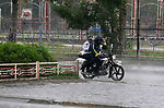 A Iraqi man ride a motorcycle in a flooded street, during a stormy day in Baghdad, Iraq, on April 9, 2020. amid the novel coronavirus pandemic .Photo by Hassani Al-Asadi