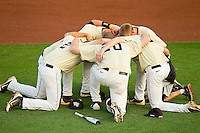 Several members of the Wake Forest Demon Deacons huddle up prior to the game against the Miami Hurricanes at NewBridge Bank Park on May 25, 2012 in Winston-Salem, North Carolina.  The Hurricanes defeated the Demon Deacons 6-3.  (Brian Westerholt/Four Seam Images)