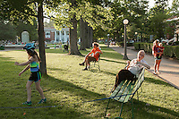 Eveningson Bestor Plaza, the main plaza of Chautauqua Institution. Families gather for ice cream, kids play violins and use the green space for play and games. Chuatuqua Institution. Photo by Brendan Bannon. June 26, 2014