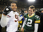 Green Bay Packers quarterback Aaron Rodgers is congratulated by Chicago Bears' Julius Peppers following the Packers 10-3 win at Lambeau Field in Green Bay, Wis.,  on Jan. 2, 2011.