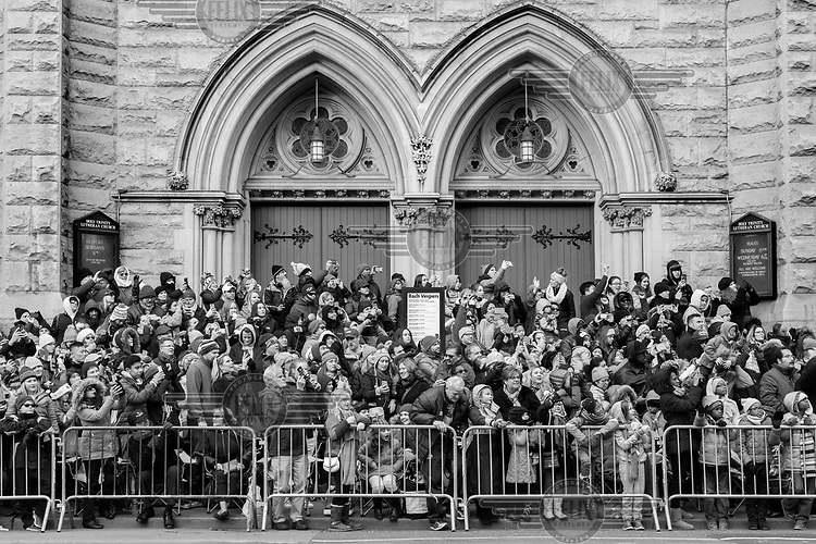 Spectators line the street at the Macy's Thanksgiving Day Parade.