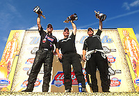 Aug. 7, 2011; Kent, WA, USA; NHRA top fuel dragster champion Del Worsham (right), funny car champion Tim Wilkerson (middle) and pro stock champion Jason Line celebrate after winning the Northwest Nationals at Pacific Raceways. Mandatory Credit: Mark J. Rebilas-