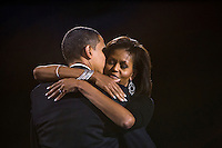 President-elect Senator Barack Obama hugs his wife Michelle during his election night rally in Chicago...Photo by Brooks Kraft/Corbis.....................