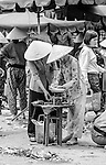 Local woman selling at the local outdoor market in Rach Gia, Vietnam