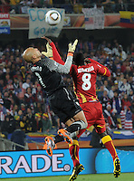 Ghana defender attempts to use his arm to know the ball from the grasp of U.S> goalkeeper Tim Howard. Ghana defeated the U.S., 2-1, in extra time to advance to the quarterfinals, Saturday, June 26th, at the 2010 FIFA World Cup in South Africa..