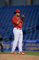 Clearwater Threshers relief pitcher Ismael Cabrera (19) looks in for the sign during a game against the Jupiter Hammerheads on April 12, 2018 at Spectrum Field in Clearwater, Florida.  Jupiter defeated Clearwater 8-4.  (Mike Janes/Four Seam Images)