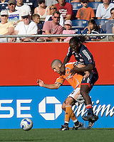 Houston Dynamo (24) Wade Barrett and New England Revolution (21) Shalrie Joseph battle for the ball. The New England Revolution and the Houston Dynamo played to a 3-3 tie in an MLS regular season match at Gillette Stadium, Foxbourgh, MA, on July 22, 2007.