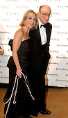 Federal Reserve Chairman Alan Greenspan, right, and his wife, NBC News correspondent Andrea Mitchell, left, arrive at the Bloomberg party following the 2005 White House Correspondents Dinner in Washington, D.C. on April 30, 2005.<br /> Credit: Ron Sachs / CNP<br /> (RESTRICTION: No New York Metro or other Newspapers within a 75 mile radius of New York City)