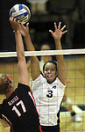 Nevada's Janelle Batista goes up for a block against Seattle University hitter Allison Farley during NCAA women's college volleyball in Reno, Nev., on Thursday, Oct. 20, 2011..Photo by Cathleen Allison