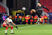 16th February 2021, Puskas Arena, Budapest, Hungary; Champions League football, FC Leipig versus Liverpool FC; Christopher Nkunku of Leipzig and Trent Alexander-Arnold of Liverpool challenge for the ball