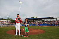 "Batavia Muckdogs pitcher Reilly Hovis (28) stands with a ""Stars of the Game"" participant for the national anthem before a game against the Brooklyn Cyclones on July 4, 2016 at Dwyer Stadium in Batavia, New York.  Brooklyn defeated Batavia 5-1.  (Mike Janes/Four Seam Images)"