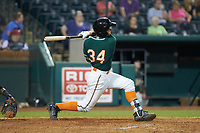 Bubba Hollins (34) of the Greensboro Grasshoppers follows through on his swing against the West Virginia Power at First National Bank Field on August 9, 2018 in Greensboro, North Carolina. The Power defeated the Grasshoppers 9-7 in game two of a double-header. (Brian Westerholt/Four Seam Images)