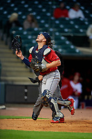 Columbus Clippers catcher Adam Moore (25) tracks a foul ball popup during a game against the Louisville Bats on May 1, 2017 at Louisville Slugger Field in Louisville, Kentucky.  Columbus defeated Louisville 6-1  (Mike Janes/Four Seam Images)
