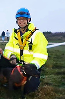 BNPS.co.uk (01202 558833)<br /> Pic: JamesFanton/BNPS<br /> <br /> Safe.<br /> <br /> A dog that plummeted 50ft off a cliff while chasing a bird has had a miracle escape after emerging from the ordeal unscathed.<br /> <br /> Tia, a Staffordshire Bull Terrier, had to be rescued after tumbling over the edge of the 120ft cliff at Hengistbury Head in Bournemouth, Dorset.<br /> <br /> She landed on a ledge unharmed, much to the relief of her owner Michelle Senjack who watched helplessly from the top.