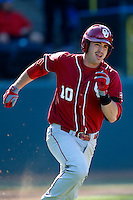 Garrett Carey #10 of the Oklahoma Sooners runs the bases against the UCLA Bruins at Jackie Robinson Stadium on March 9, 2013 in Los Angeles, California. (Larry Goren/Four Seam Images)