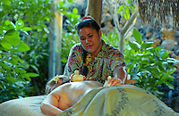 Woman recieving Thai herbal pouch treatment at the Mauna Lani spa on the Big Island of Hawaii