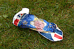 Merthyr Tydfil - UK - 26th April 2012 : Crumpled up Queen Diamond Jubilee flag on the grass during the Queen and the Duke of Edinburgh's visit to Cyfarthfa Castle museum and art gallery in Merthyr Tydfil this afternoon.  The Queen and Prince Philip are visiting towns and cities all over the United Kingdom to mark the Diamond Jubilee year.