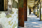 Corridor in Camouflage military bungers.  Abandoned military gunnery bunkers at Fort Worden State Park, Port Townsend, WA.  Cubist, abstract, representaional.