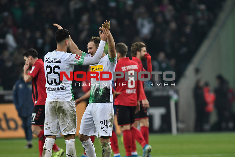 01.12.2019, Borussia-Park - Stadion, Moenchengladbach, GER, DFL, 1. BL, Borussia Moenchengladbach vs. SC Freiburg, DFL regulations prohibit any use of photographs as image sequences and/or quasi-video<br /> <br /> im Bild Ramy Bensebaini (#25, Borussia Mönchengladbach) Tony Jantschke (#24, Borussia Moenchengladbach) feiern den Sieg<br /> <br /> Foto © nordphoto/Mauelshagen