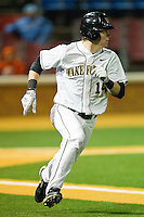 Conor Keniry #14 of the Wake Forest Demon Deacons hustles down the first base line against the North Carolina Tar Heels at Gene Hooks Field on March 11, 2011 in Winston-Salem, North Carolina.  Photo by Brian Westerholt / Four Seam Images