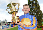 10.09.2011 The National Stakes from The Curragh.. Jockey Seamie Heffernan holds the trophy aloft after winning the group 1 Goffs National Stakes at the Curragh race course.