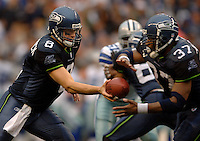 Oct 23, 2005; Seattle, Wash, USA;  Seattle Seahawks quarterback #8 Matt Hasselbeck hands off the ball to running back #37 Shaun Alexander against the Dallas Cowboys in the fourth quarter at Qwest Field. Mandatory Credit: Photo By Mark J. Rebilas