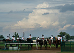 The pony horses and riders prepare to accompany the jockeys and their rides from the paddock to the gate to compete in the Runhappy Ellis Park Derby's 10th race for a $200,000 purse at Ellis Park in Henderson, Ky., Sunday afternoon, Aug. 9, 2020. The race is a qualifier for the upcoming Sept. 5, 2020, Kentucky Derby, with 85 points (50-20-10-5) up for grabs.