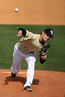 UCF Knights pitcher Garrett Nuss #11 delivers a pitch during a game against the Siena Saints at the UCF Baseball Complex on March 4, 2012 in Orlando, Florida.  Central Florida defeated Siena 15-2.  (Mike Janes/Four Seam Images)