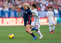 FRISCO, TX - MARCH 11: Lindsey Horan #9 of the United States is fouled by Mina Tanaka #15 of Japan during a game between Japan and USWNT at Toyota Stadium on March 11, 2020 in Frisco, Texas.