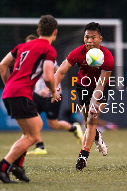 Maverick Lim Yong Chen (r) of Singapore in action during the match between United Arab Emirates and Singapore of the Asia Rugby U20 Sevens Series 2016 on 12 August 2016 at the King's Park, in Hong Kong, China. Photo by Marcio Machado / Power Sport Images