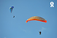 Two Paragliders flying in air (Licence this image exclusively with Getty: http://www.gettyimages.com/detail/95794851 )