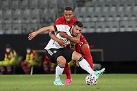 Matthias Jörgensen (Dänemark, Denmark) haelt Kevin Volland (Deutschland Germany) - Innsbruck 02.06.2021: Deutschland vs. Daenemark, Tivoli Stadion Innsbruck