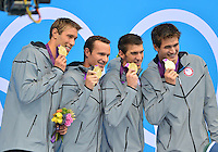 August 04, 2012..Matt Grevers, Brendan Hansen, Michael Phelps, Nathan Adrian, pose with the Gold Medal during award ceremony for 4x100m Medley Relay at the Aquatics Center on day eight of 2012 Olympic Games in London, United Kingdom.