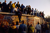 West Berlin, West Germany<br /> November 10, 1989<br /> <br /> West Germans climb the wall at Brandenburg Gate. Germans gathered at the wall after the East German government lifted travel and emigration restrictions to the West the day before.