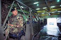 - navy infantrymen of S.Marco battalion in the hold of an amphibious ship waiting for the landing....- fanti di marina del battaglione S.Marco nella stiva di una nave anfibia in attesa dello sbarco